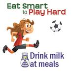 Eat smart to play hard girl kicking soccer ball drink milk at meals